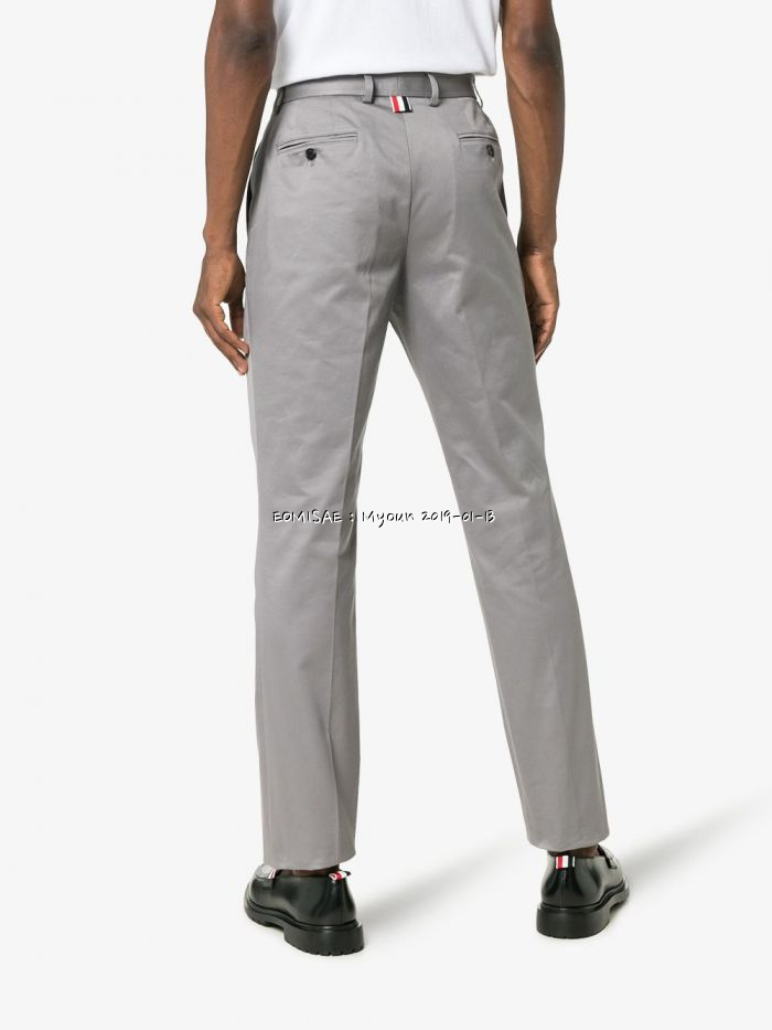 thom-browne-grey-logo-patch-tailored-cotton-trousers_12559502_15549198_1000.jpg
