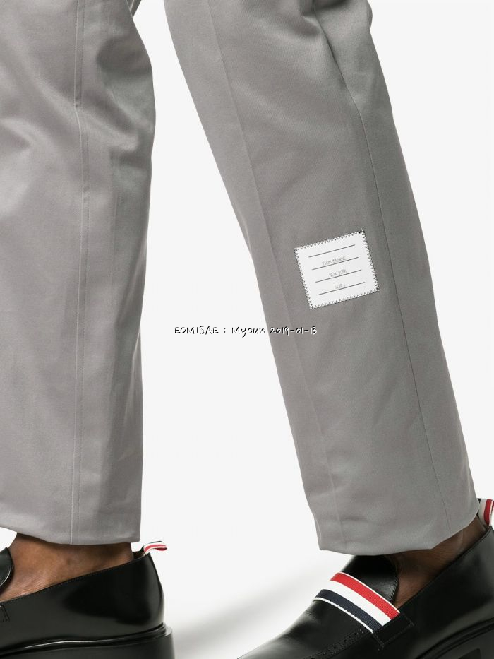 thom-browne-grey-logo-patch-tailored-cotton-trousers_12559502_15549199_1000 (1).jpg